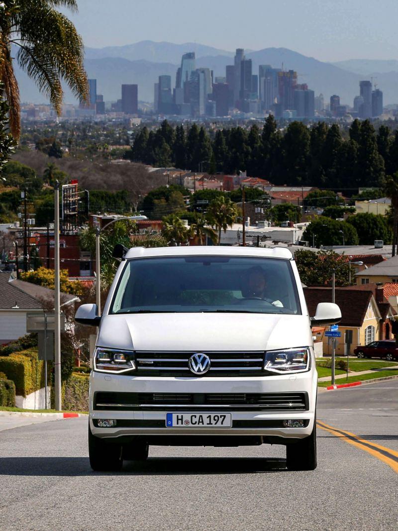 California van driving uphill in California