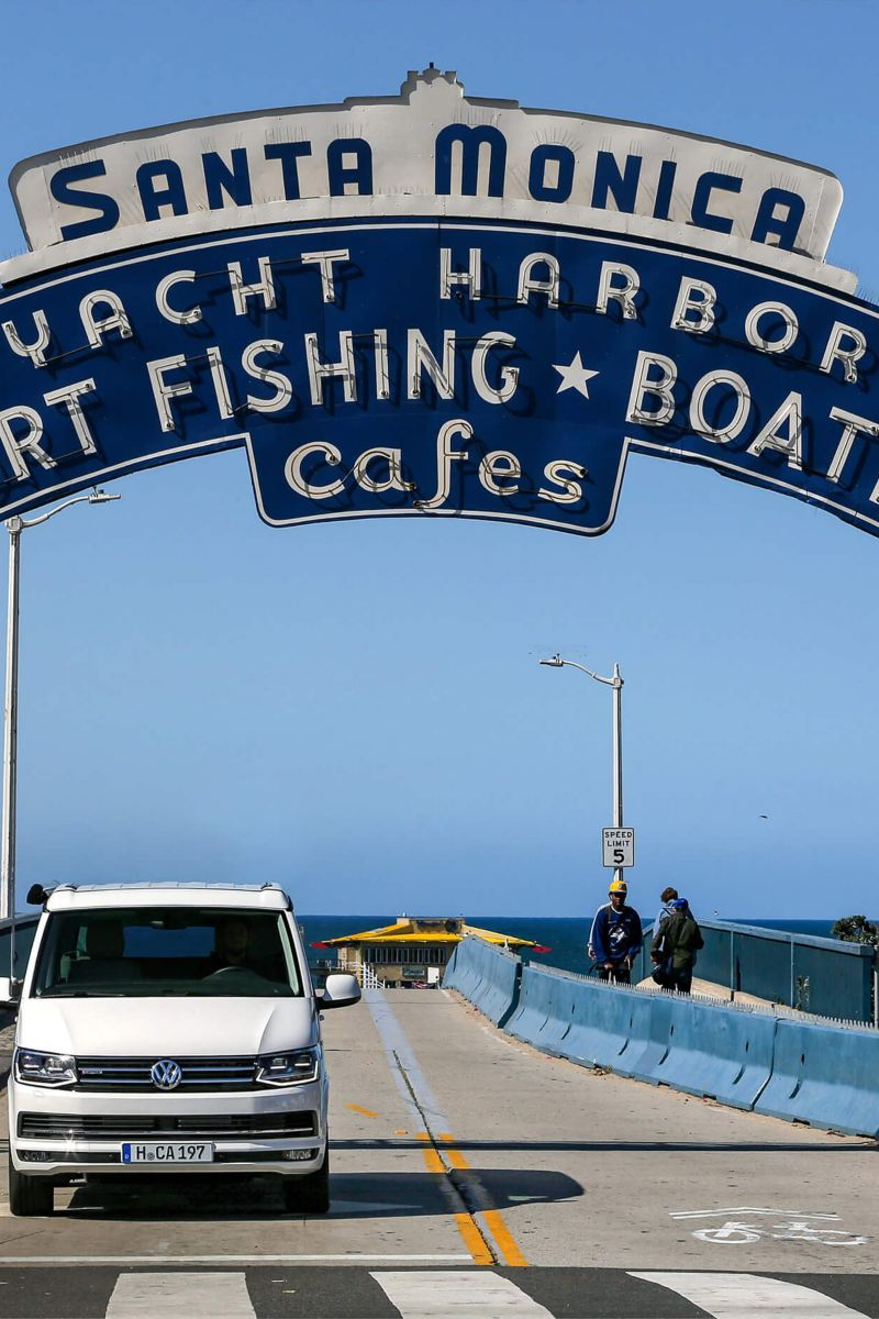 VW California parked on pier with historic signs