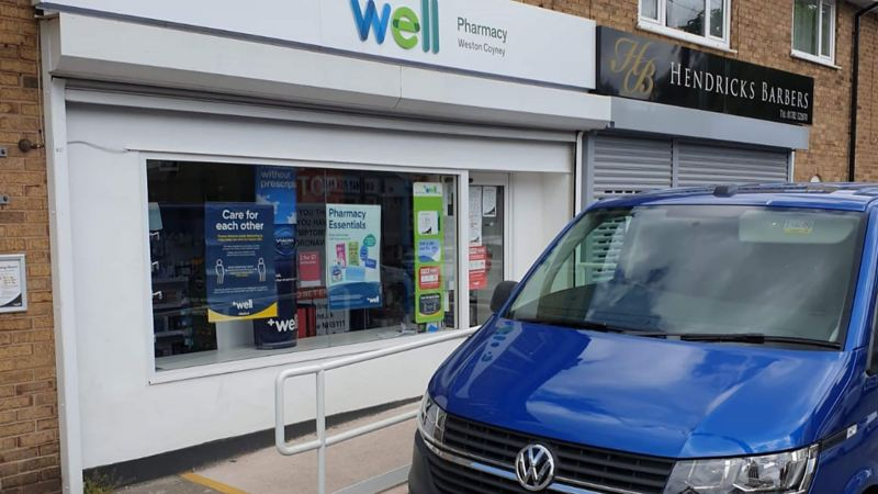 Transporter T6.1 in front of a Wells pharmacy