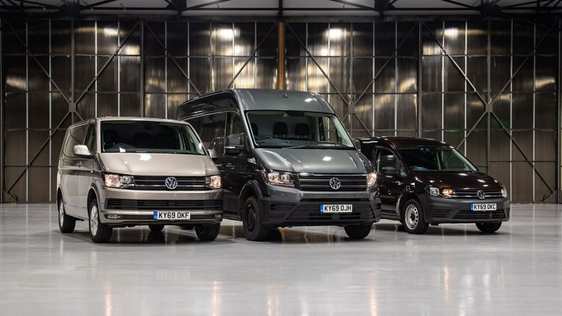 three panel vans in warehouse side by side