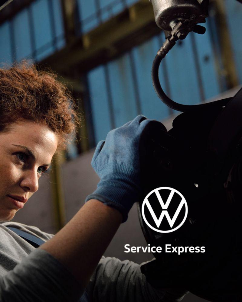 Volkswagen mechanic fixing vehicle
