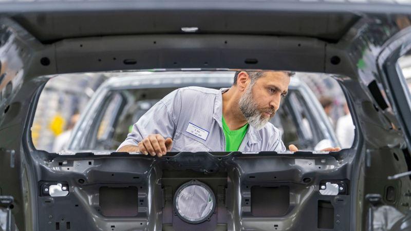 VW employee working at Volkswagen plant Wolfsburg