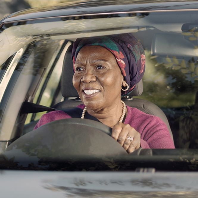 lady driving a vw vehicle