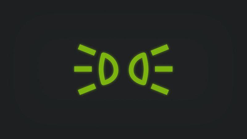 Kontrollleuchte mit zwei gespiegelten Scheinwerfern leuchtet grün
