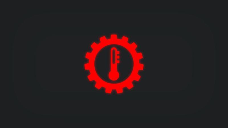 Kontrollleuchte mit Thermometer in Zahnrad leuchtet rot