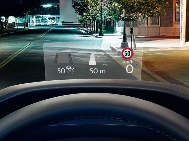 The head-up-display, showing speed, directions, and speed limit, in the Volkswagen Tiguan