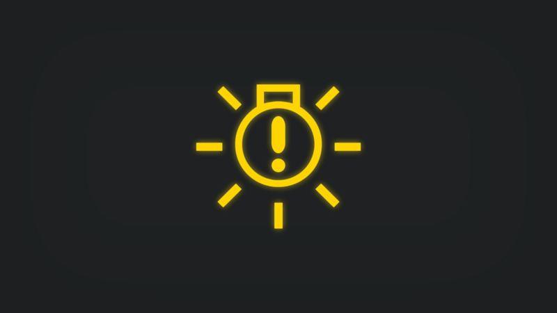 Kontrollleuchte mit Ausrufezeichen in Glühbirne leuchtet gelb