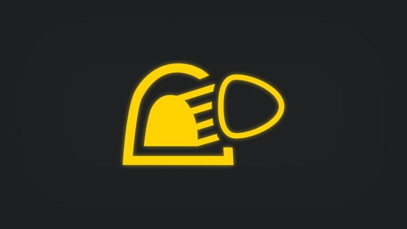 Kontrollleuchte mit Scheinwerfer, der in Tunnel scheint, leuchtet gelb