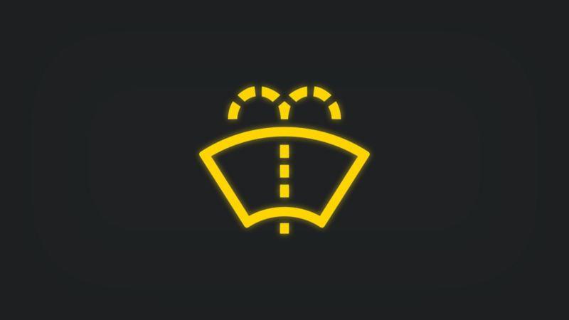 Kontrollleuchte mit Windschutzscheibe und Wasserstrahl leuchtet gelb