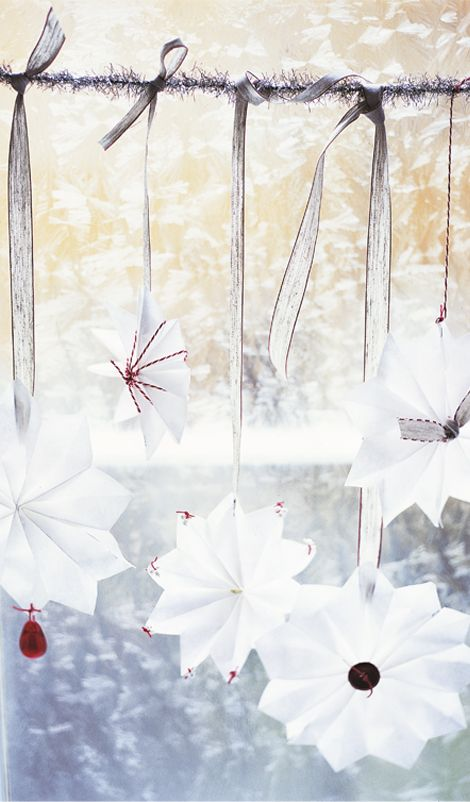 Create a snowfall with a flurry of paper snowflakes